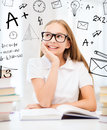 Student girl studying at school education and concept little and reading books Stock Photos