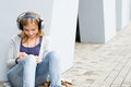 Student girl writing and listening to music Royalty Free Stock Photo