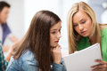 Student girls looking at notebook at school education concept Stock Image