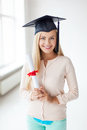 Student in graduation cap with certificate happy Stock Photography