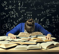 Student Hard Study, Tired Bored Woman Read Books over Blackboard Royalty Free Stock Photo