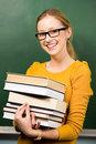 Student holding books Stock Photo