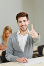 Student holding thumbs up Stock Photo