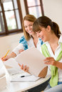 Student at home - two happy woman with laptop Royalty Free Stock Photo