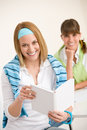 Student at home - two young woman study together Royalty Free Stock Photo