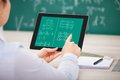 Student learning mathematical equations close up of on digital tablet Royalty Free Stock Photography