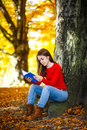 Student learning outdoor girl reading book in park Royalty Free Stock Photography