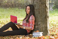Student learning using laptop outdoors in beautiful autmn day Stock Image
