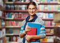 Student in library portrait of clever with books college Stock Photo