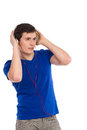 Student is listening to music handsome in blue t shirt with headphones waist up studio shot isolated on white Stock Photo