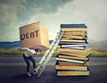 Student loan debt. Woman with heavy box debt carrying it up education ladder