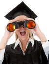 Student looking through binoculars Stock Images