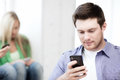Student looking at phone and tiping technology concept Stock Photography