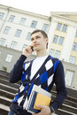 Student man talking on the phone Royalty Free Stock Image