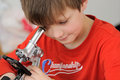 Student with microscope young working on experiment Royalty Free Stock Images