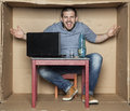 Student presents his dorm room man in the box Stock Photography