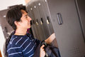 Student putting things in locker Royalty Free Stock Photo