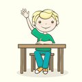 Student raised his hand the boy answers the question a sitting at the table Royalty Free Stock Photos