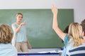 Student raising hand in classroom Royalty Free Stock Photo