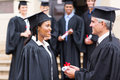Student receiving certificate pretty african from dean Stock Photo