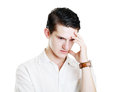 Student showing tired handsome young businessman or or headache gesture isolated on white background Stock Image
