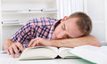 Student sleeping at desk on books Royalty Free Stock Photo