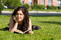 Student studying on the grass Stock Photography