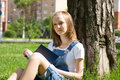Student studying on the grass Royalty Free Stock Photo