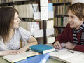 Student talking in library male and female Royalty Free Stock Images