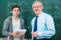 Student with a teacher in classroom Stock Photos
