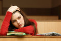 Student teen girl tired in empty classroom university Royalty Free Stock Photo
