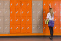 Student unlocking school locker Royalty Free Stock Photo