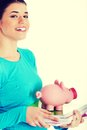 Student woman holding workbook and piggy bank casual Royalty Free Stock Images