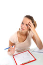 Student writing a test seeks inspiration Royalty Free Stock Photography