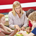 Students in biology class in school learning elementary with a teacher Royalty Free Stock Photo