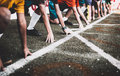 Students boy get set to leaving the starting for running competition boy at school sports day. Royalty Free Stock Photo