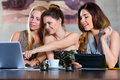 Students or businesswomen working in cafe young women colleagues a restaurant on some documents contract with laptop and tablet Royalty Free Stock Photography