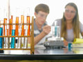 Students with chemistry experiment focus on beakers Royalty Free Stock Photography