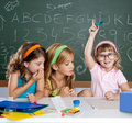 Students with clever children girl raising hand Royalty Free Stock Photo