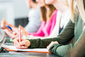 Students in college learning Royalty Free Stock Photo