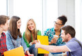 Students communicating and laughing at school education concept Royalty Free Stock Photo