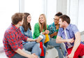 Students communicating and laughing at school education concept Stock Photos