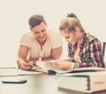 Students couple preparing for exams young behind table Royalty Free Stock Image