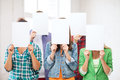 Students covering faces with blank papers education concept group of Royalty Free Stock Photo