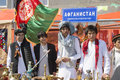Students demonstrate afghan national costumes people in costume at the international festival in moscow in may Royalty Free Stock Photo