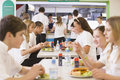 Students eating in the school cafeteria Stock Image