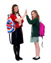 Students giving high five to each other Royalty Free Stock Photo
