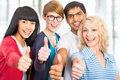 Students giving the thumbs up sign group of happy Royalty Free Stock Images