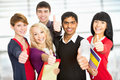 Students giving the thumbs up sign group of happy Stock Image