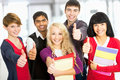 Students giving the thumbs up sign group of happy Stock Photos
